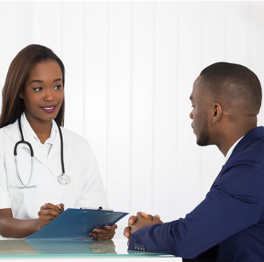 A male patient consulting a femal doctor